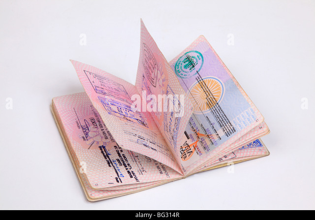 UK Passport pages with destination stamps from different countries. - Stock-Bilder