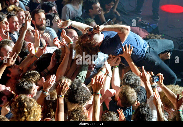 BARCELONA - MAY 30: The guitar player of Ty Segall (band) performs above the spectators (crowd surfing or mosh pit). - Stock Image