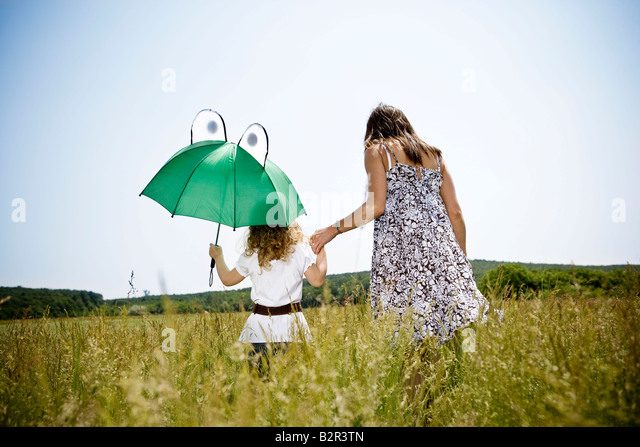 Mother and daughter walking - Stock Image