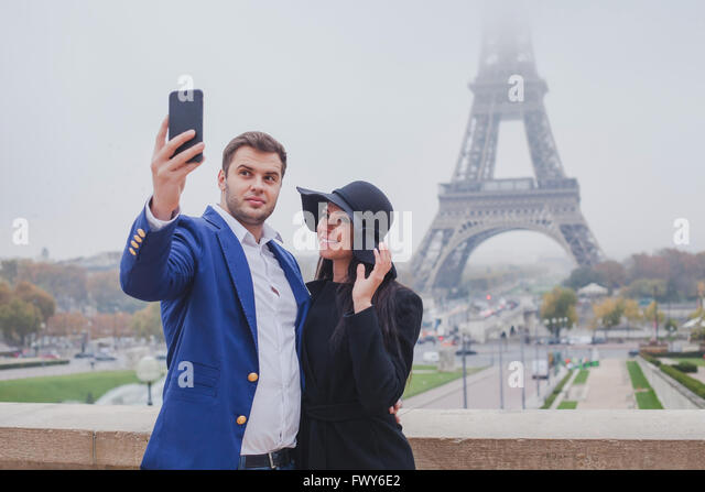 couple of tourists taking photo with Eiffel Tower in Paris, selfie, tourism in Europe, France - Stock Image