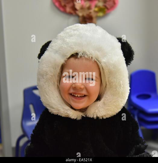 portrait-of-a-smiling-boy-in-a-panda-cos