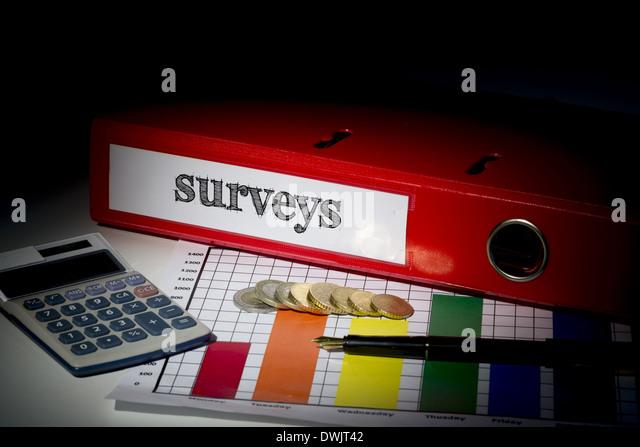 Surveys on red business binder - Stock Image