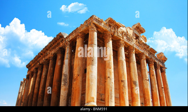 Jupiter's temple ancient Roman columns over blue sky, Baalbek, Lebanon - Stock Image