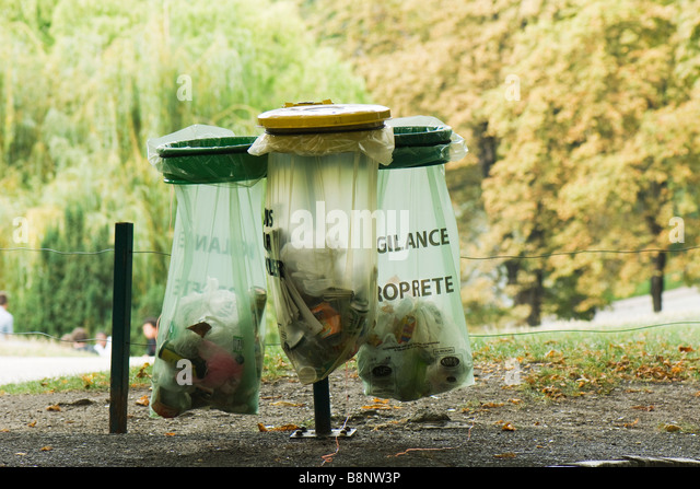 France, Paris, garbage receptacles in park - Stock Image