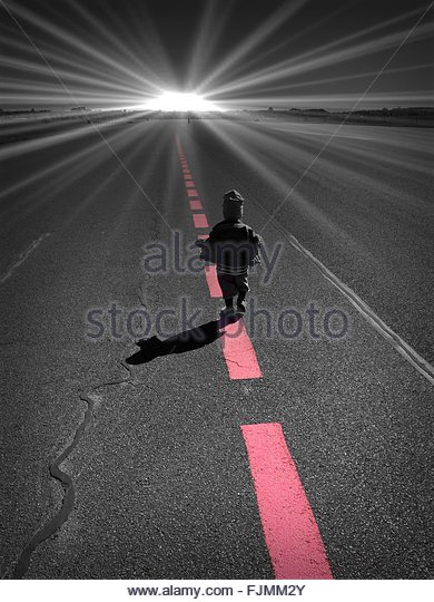 Full Length Rear View Of Child Walking On Street Against Bright Sun - Stock-Bilder