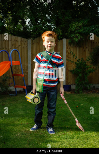 9 year old boy role playing as an explorer - Stock Image