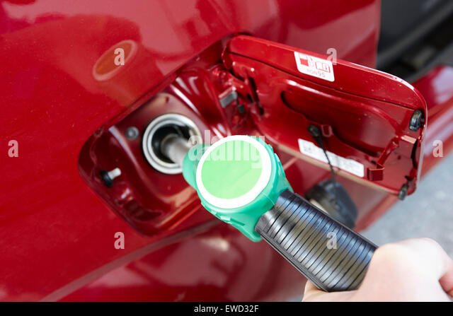 filling vehicle with unleaded petrol - Stock Image