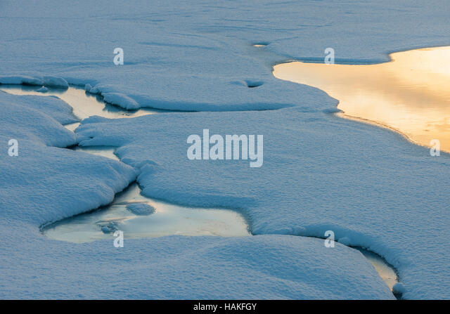 Frozen Snowy Fjord Lake in Winter, Nordbotn, Troms, Norway - Stock Image