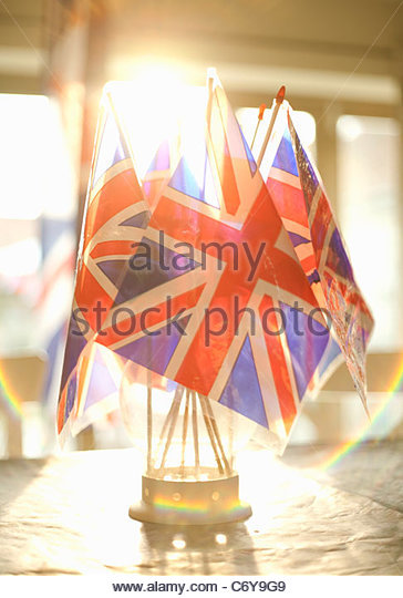 Union Jack flags in glass on table - Stock Image