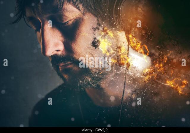 DJ on fire, man with burning headphones enjoying favorite song or music, selective focus - Stock-Bilder