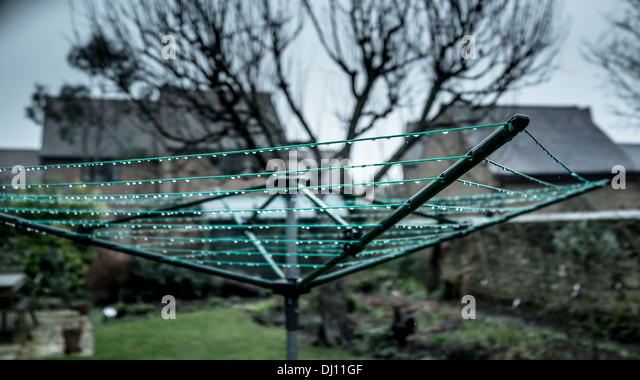 Whirly gig washing line with water droplets - Stock Image