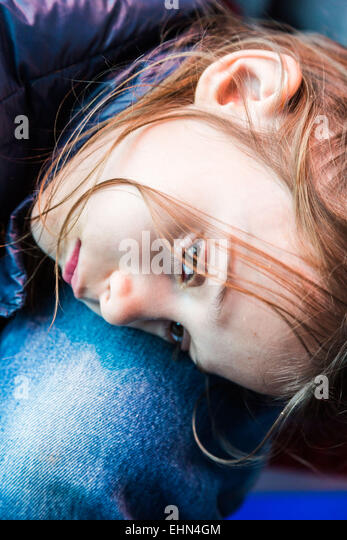 7 year old girl with her father. - Stock Image