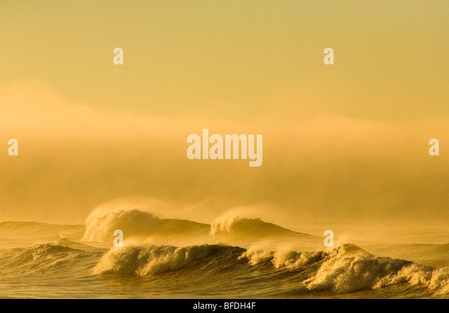 Waves crash to the beach at Cape Agulhas at the southern tip of Cape Town, South Africa. - Stock Image