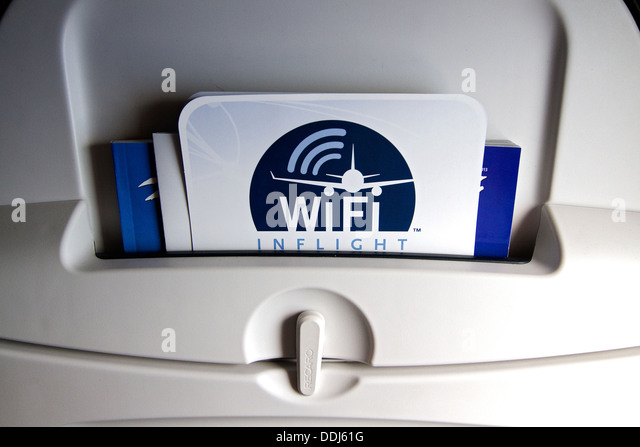 Inflight WiFi advertised on the back of airplane seat. WiFi the next generation of inflight entertainment. - Stock Image