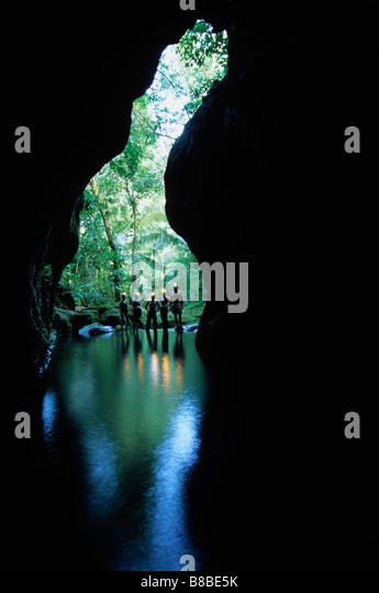 People Look into Cave Entrance, Belize - Stock-Bilder