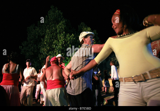 People dancing on the street, Trinidad, Cuba island, West Indies, Central America - Stock Image
