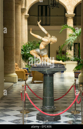 Cuba Old Havana La Habana Vieja Calle Obrapia Hotel Florida 1885 reception Art Deco statue sculpture dancing girl - Stock Image