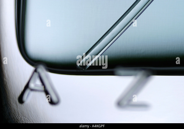 Letters and design on glass bottle, extreme close-up - Stock Image