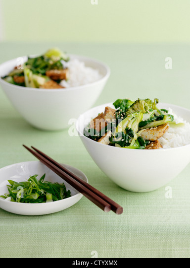 Bowl of rice with broccolini - Stock Image