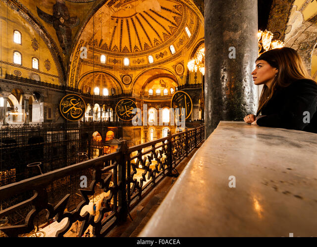 Young woman inside Hagia Sophia mosque, Istanbul, Turkey - Stock Image