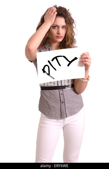 Young attractive woman holding paper with Pity text on white background - Stock Image