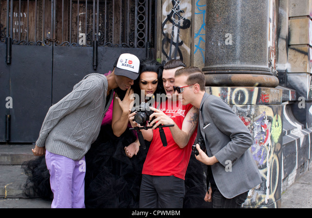 A video team reviews a fashion shoot with the model on The Bowery in New York City Stock Photo