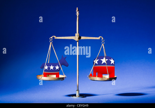 Studio shot of weight scale with political parties symbols - Stock Image