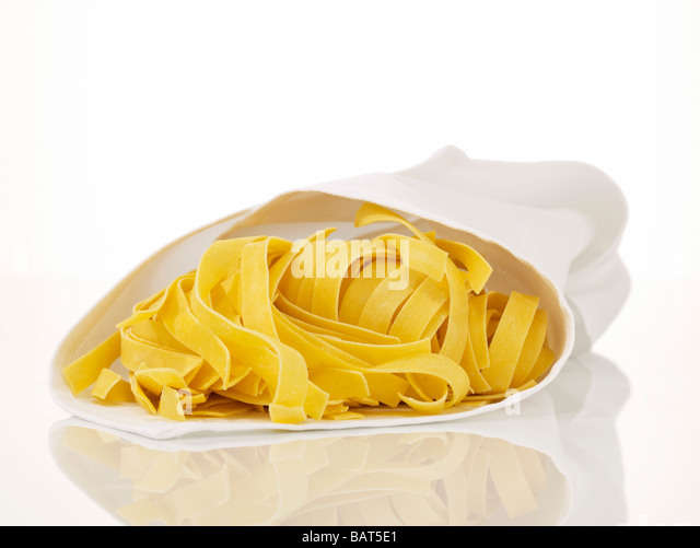 Uncooked pasta wrapped in dish towel, close-up - Stock Image