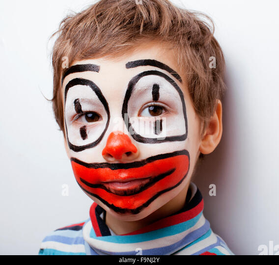 little cute boy with facepaint like clown, pantomimic expressions close up - Stock Image