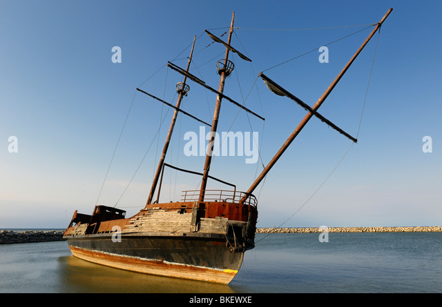 Listing wreckage of the replica of the Cartier Big Weasel in Jordan Harbour Niagara Canada - Stock Image