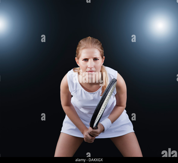 Tennis player poised in game - Stock Image