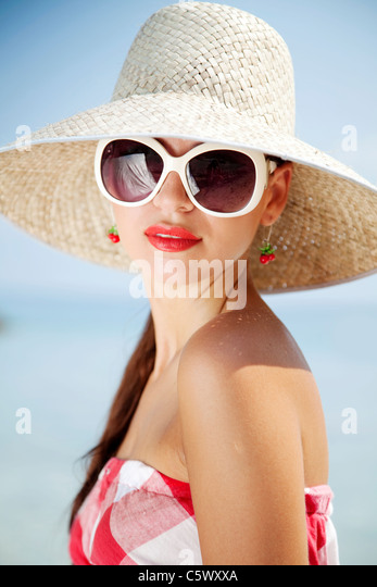 portrait of female in 50s summer outfit on the beach - Stock Image