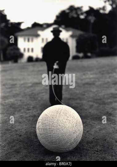 Executive 'man on suit'  Caucasian man black and white suit  holding a ball of string - Stock-Bilder