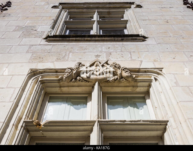 Architectural detail over old stone window, Chinon, France. - Stock Image