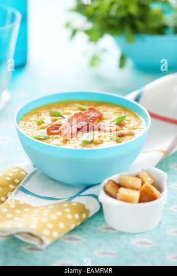 Pea soup with bacon and spring onion - Stock Image