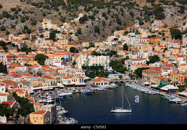 Greece, Symi island, Dodecanese. Panoramic view of Gyalos, capital and main port of the island. - Stock-Bilder