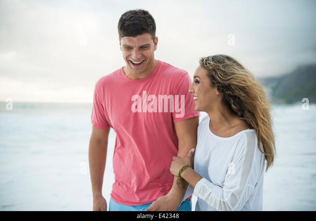 Young couple on Ipanema Beach, Rio de Janeiro, Brazil - Stock Image