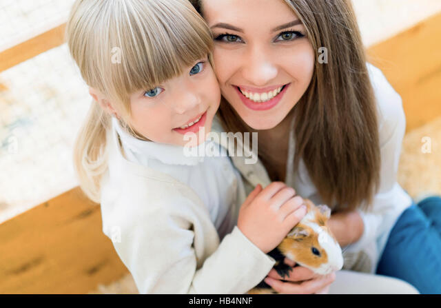 Family with cavy - Stock Image