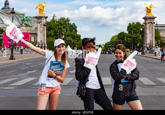 Paris, France. 24th Jun, 2017. Three women promoting and supporting the Paris Olympic Games 2024 on Alexander III - Stock Image