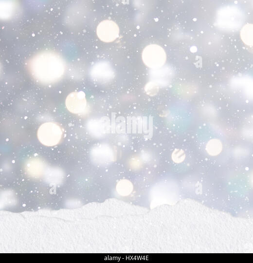 Mounds of snow on a silver Christmas background with stack of presents - Stock Image