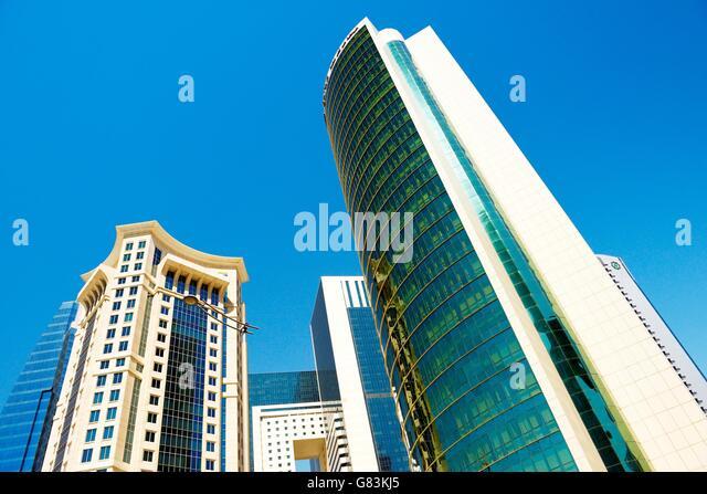 City centre West Bay area of Doha, Qatar. Majlis Al Taawon Street. Left is Burj Al Qassar Tower right is Olympic - Stock Image