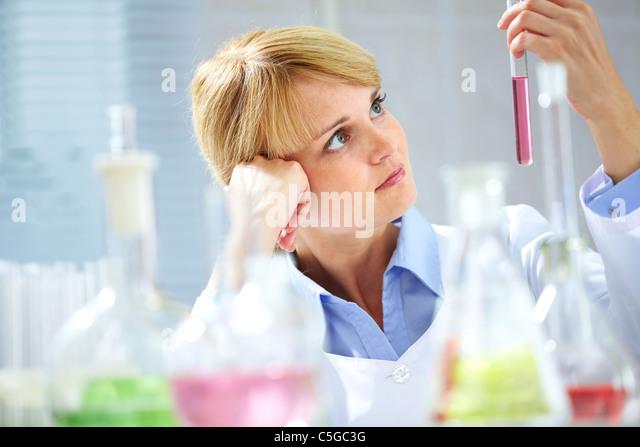 Pensive chemist - Stock Image