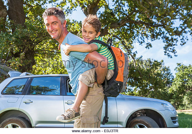 Father And Son Enjoying Walk In Countryside Trip - Stock Image
