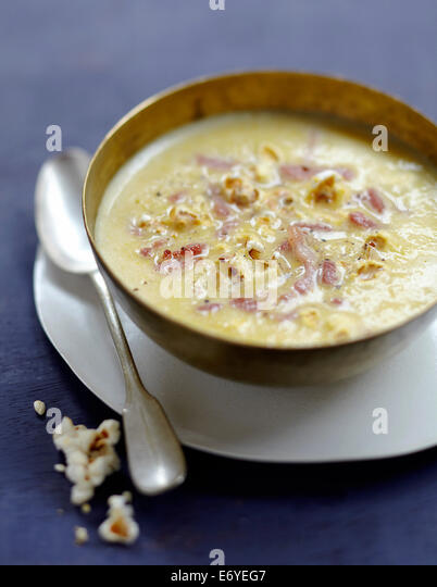 Sweetcorn soup with diced bacon and popcorn - Stock Image