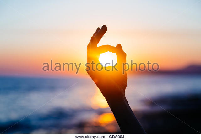 Ok hand sign silhouette at sunset - Stock Image