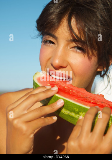 Young Woman Eating Watermelon - Stock Image