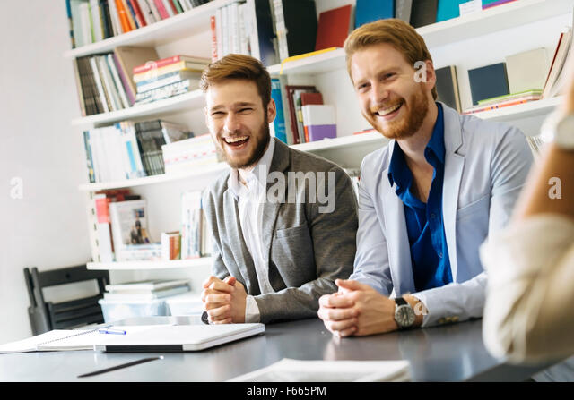 Business smiling and laughing sincerely - Stock Image
