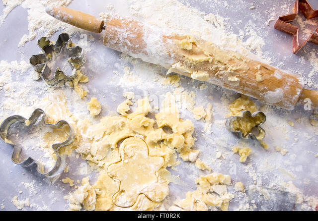 Baking Holiday Cookies (Messy Counter) - Stock Image