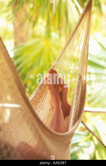 Close up of womans feet in hammock Tulum Quintana Roo Mexico model released image - Stock-Bilder
