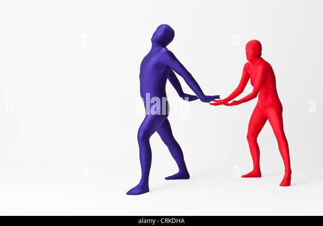 Couple in bodysuits with invisible globe - Stock Image